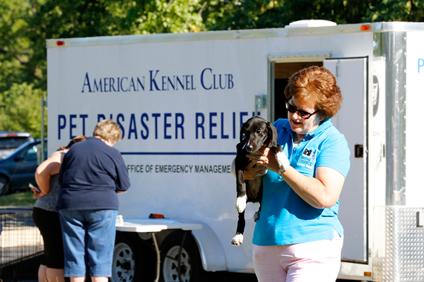 Holding a Puppy Outside AKC Pet Disaster Trailer in Missouri